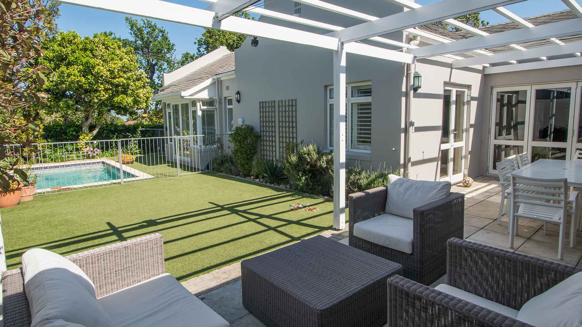 Immaculate, modern lock-and-go home adjacent to Wynberg Boys School – on the border of Upper Kenilworth